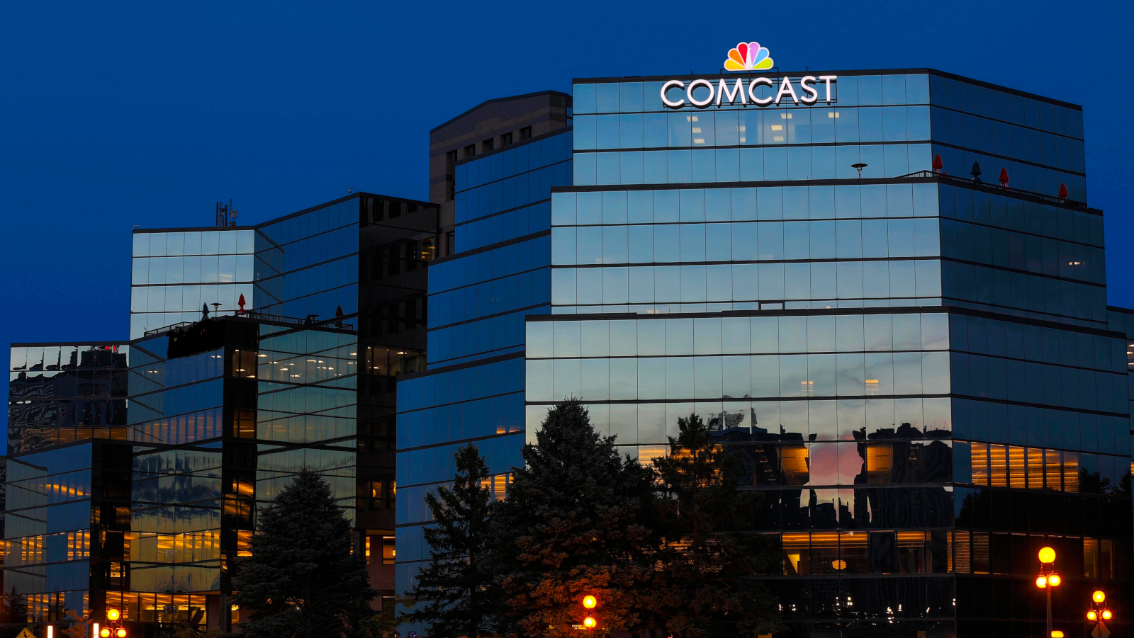 Exterior view of the Comcast Twin Cities Regional office at dusk.