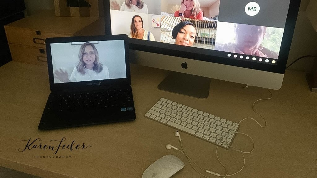 A laptop displays a video conference call